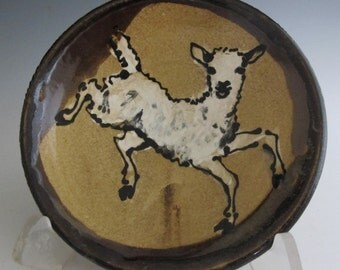 Plate with happy lamb slip trailed pottery plate