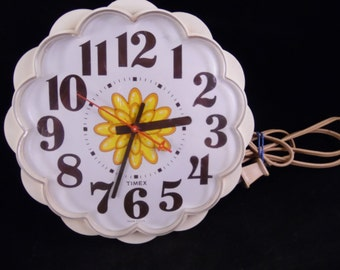 Vintage Timex White Electric Kitchen Clock with Yellow Flower Center