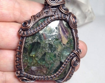 Large woven wire wrapped Fluorite with Pyrite veining, pendant