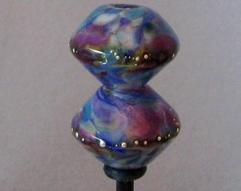 Pair of soft colored bicone lampwork beads with silver droplets