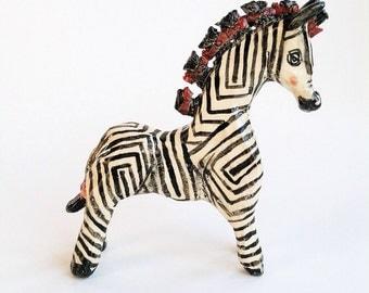 Zebra with fancy hairdo ceramic animal figurine