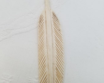 Carved bone feather bead