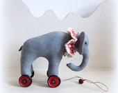 Little  elephant on vintage red Meccano wheels