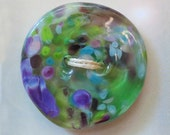 Monet's Garden - art glass button - transparent greens with purple, blue and green speckles - two hole