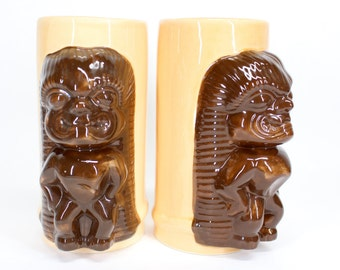 Pair of vintage Tiki mugs . Souvenirs from Waikiki made by Daga or Hawaii . Al Harrington South Pacific Man . Tropical peach for your bar