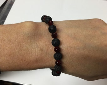 Volcanic rock and red glass beads.