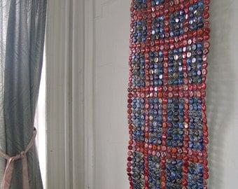 red framing blue - bottle cap tapestry