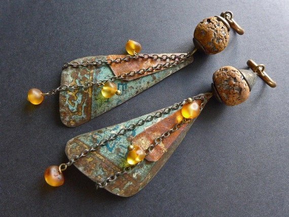 Igniparous.  Tin, amber and polymer earrings.