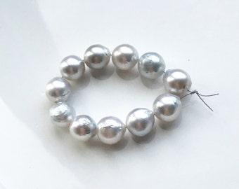 Lovely Light Silver Platinum Genuine Baroque Maluku Island Pearls - Parcel of (11)