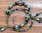 Green, Lavender and Black Beaded Bracelet - Lampwork Bracelet - Charm Bracelet - Elegant Bracelet - Double Strand - Antique Bronze