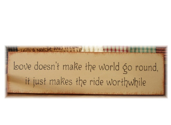 Love doesn't make the world go round  it just makes the ride worthwhile primitive wood sign