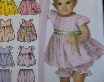 Simplicity 3854 Babies Dress or Jumper, Top, Pantaloons and Bolero in sizes xxs-L
