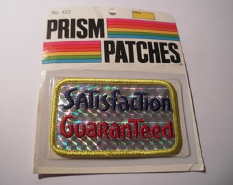 Laser Prism Patch SATISFACTION GUARANTEED Disco 1970s 1980s NOS red blue silver hologram shiny slogan