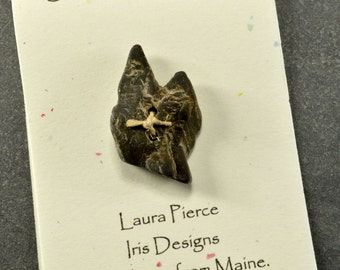 Humorous little cat face  a quirky black natural Maine sea stone   eco friendly statement for sweaters jackets and knits