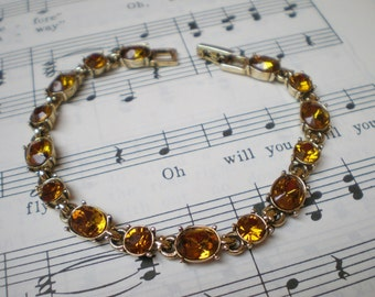 Vintage Topez Bracelet, Topaz Amber Colored Rhinestones, Gold Tone Metal, Clasp Closure, Signed Lc, Nice Condition, Costume Jewelry