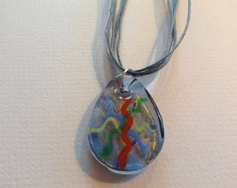 Multi glass pendant on cord and ribbon