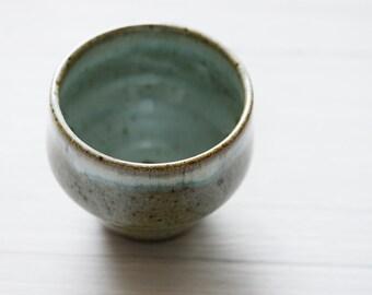 A Wheel Thrown tea cup geometric shape