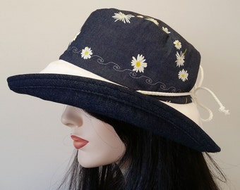 Sunblocker - Navy indigo large brim sun hat with adjustable fit featuring white daisies