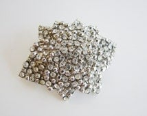 Vintage silver flower brooch with clear crystal/ rhinestone accents (I2)