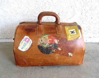 Vintage Brown Leather Doctors Bag with Travel Stickers. Circa 1950's.