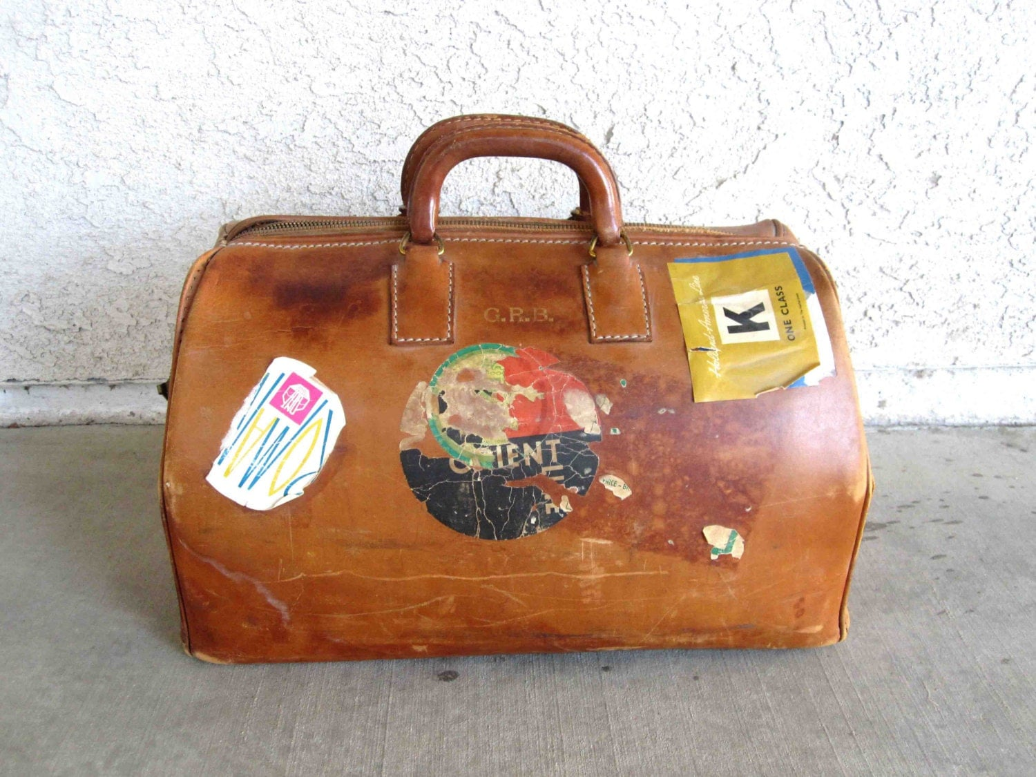 Vintage Brown Leather Doctors Bag with Travel Stickers. Circa