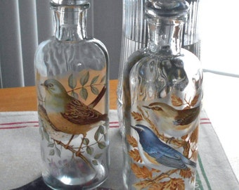 2 Glass Apothecary bottles with vintage water slide bird decals