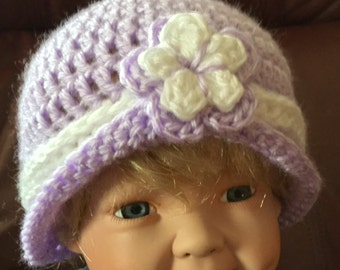 Lilac hat with flower and stripe