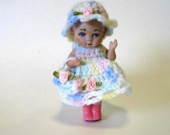 "doll 5"" handcrafted in porcelain dressed in multi-colored crocheted dress, bonnet , and purse"
