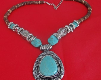 "Vintage silver tone 21"" necklace with 2.5"" faux turquoise pendant, appears unworn, strung on wire"