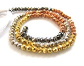 Mixed titanium coated Pyrite faceted rondelles, 3.75mm, 13 inch strand
