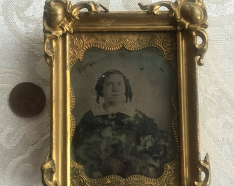 Antique picture frame with old photo
