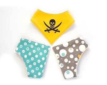 Eco friendly baby bib with with skull in yellow, blue and grey. Organic cotton bibs for baby boy.