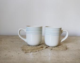 pair of striped mugs