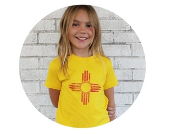 Distressed Zia Sun Symbol Youth Tee Shirt, Short Sleeved Cotton Crewneck in Bright Lemon Yellow, New Mexico Flag, Native American Symbol