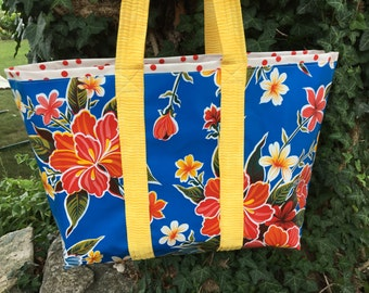 hibiscus patterned floral oilcloth tote bag on royal blue