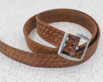 vintage tooled leather belt with a lattice pattern