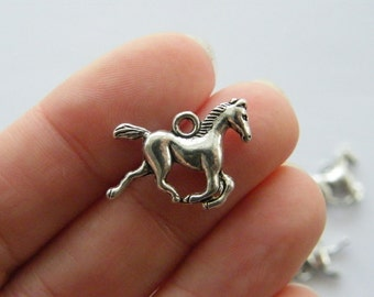 10 Horse charms antique silver tone A589