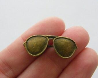 6 Sun glasses charms antique bronze tone BC121