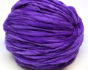 Handspun yarn, 100 yards and 3.15 ounces/89 grams spun thick and thin in hand dyed merino wool
