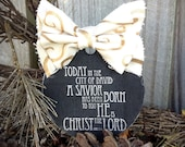 A savior is born ~  wood ornament  gold and antique ribbon