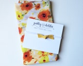 Baby girl swaddle blanket and headband set. Happy yellow and orange poppy flowers with a matching felt bow