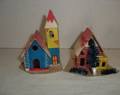 D) Two Small Cardboard Christmas Houses