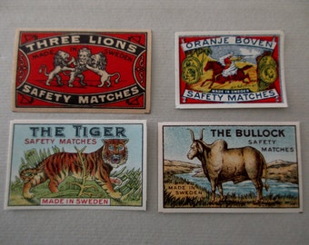 4 antique 1910s Swedish matchbox papers - labels, red, blue, tiger, bullock, lion, horse