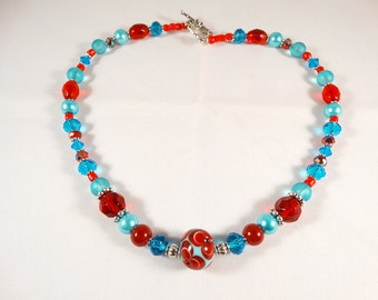 Blue and Red Necklace with Floral Lampwork Focal Bead