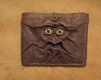 Grichels leather bi-fold wallet - dark chocolate brown with honey brown and green slit pupil bobcat eyes
