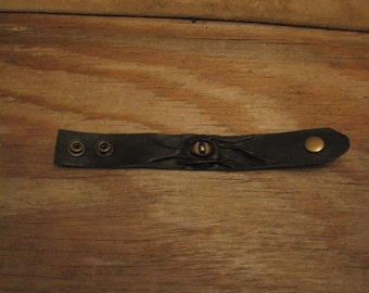 Grichels leather wrist cuff/bracelet - black with red and gold slit pupil shark eye