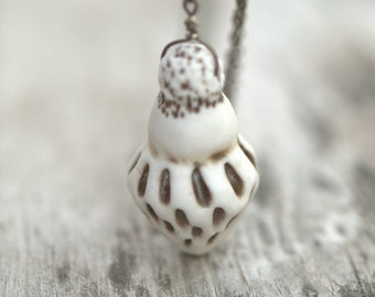 Seed pod necklace with long chain.  Wearable sculpture.  Ceramic jewelry.  One of a kind.  Unique.