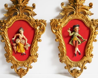 2 Vintage Gold Syroco ornate frames w/ figures Colonial French Victorian Man Woman Parasol Matching set pair framed figures