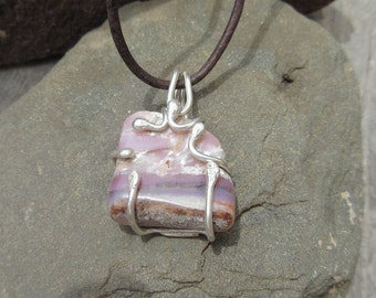 Pink Opal Pendant...LIFE SPARK features a piece of polished Pink Opal from Australia that is set in a one of a kind Silver setting.