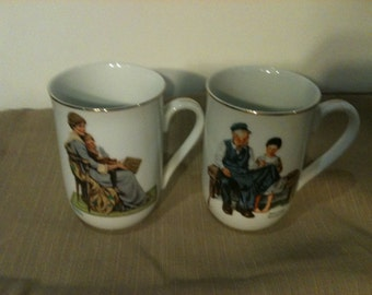 Pair of Norman Rockwell Porcelain Cups